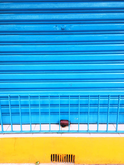 Closed shutter of all blue window