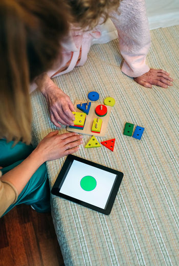 High angle view of child playing with toy on table at home