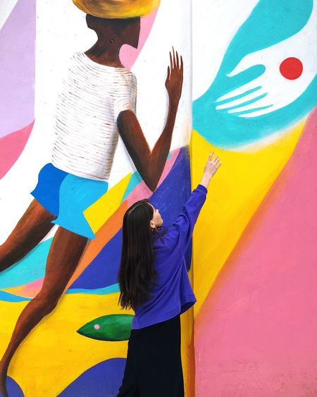 Helping hand Portrait Of A Woman Help Helping Hand Helloworld Lifestyle Colored Background Multi Colored Multi Colored Creativity Art And Craft Real People Wall - Building Feature One Person Lifestyles Graffiti Leisure Activity Built Structure Women Casual Clothing Wall Human Arm Street Art Arms Raised Architecture
