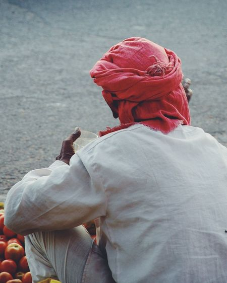 Rear View Of Man Selling Tomatoes At Street Market