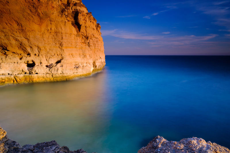 Water Sea Horizon Over Water Scenics Tranquil Scene Beauty In Nature Tranquility Idyllic Blue Sky Cliff Rock Formation Seascape Outdoors Photography Xseries Travel Destinations X-PRO2 Portugal Algarve Fujifilm Carvoeiro Xpro2 Summer Longexposurephotography