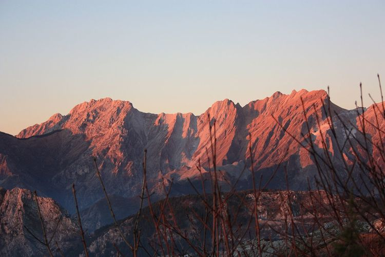 Colorful sunset over the mountain peaks on the apuan alps of tuscany in italy