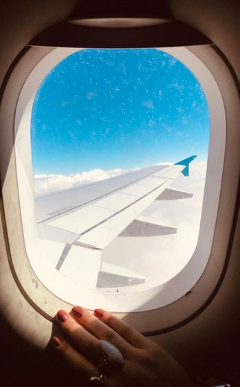 Travel Airplane Air Vehicle Window Flying Sky Human Hand Human Body Part Sunlight Journey Nature Cloud - Sky One Person Travel Day Vehicle Interior Mode Of Transportation Hand Aircraft Wing Transportation Body Part