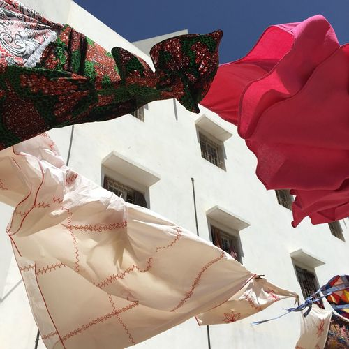 Summer Breeze in Dakar Flower Pattern Fashion Love  African Fashion Women Fashion Clothes On Clothesline Summer Spring Romance Tender Dakar Summer Breeze Clothes In The Wind Clothes Drying Nature Red Building Exterior Low Angle View Architecture Day No People Sky Outdoors Sunlight Textile