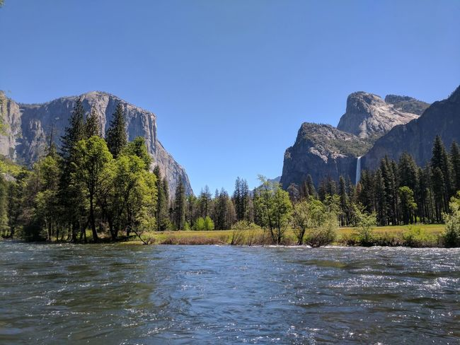 Travel Destinations Iconic Landscape Yosemite National Park Outdoors Scenics Spring Mountain Peak Mountain Landscape Water Sky Tree Mountain Range Summer Day Vacations Nature Clear Sky Beauty In Nature California