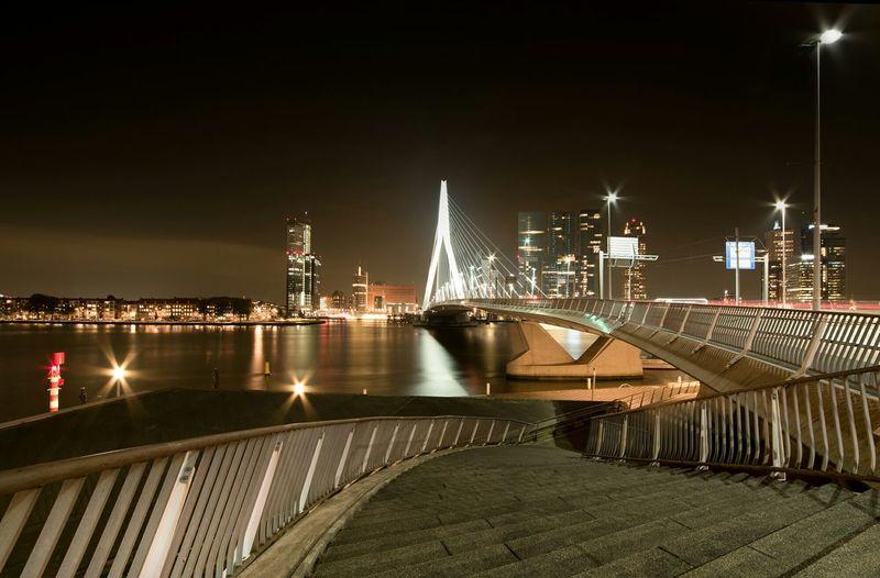 Erasmus Bridge Over River Against Sky In Illuminated City At Night