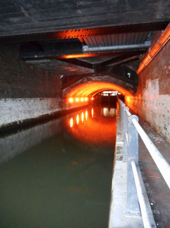 Manchester canal, UK. Bridge Canal Walks City Centre Illuminated Manchester Canal Orange Light Perspective Railing Tunnel Under The Bridge Water