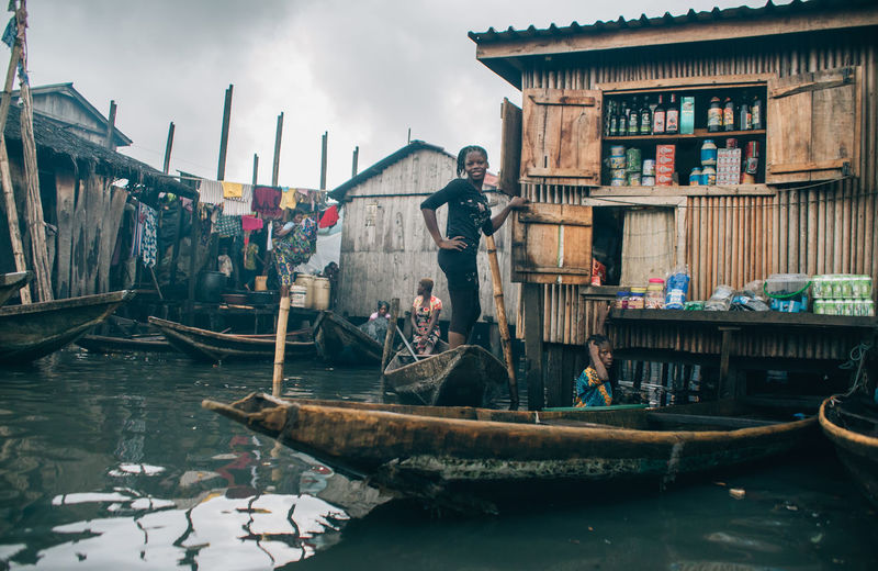Makoko Slum TheWeekOnEyeEM Architecture Building Exterior Built Structure Day Fisherman Group Of People Men Mode Of Transportation Moored Nature Nautical Vessel Oar Occupation Outdoors People Real People River Rowboat Sky Transportation Water Waterfront