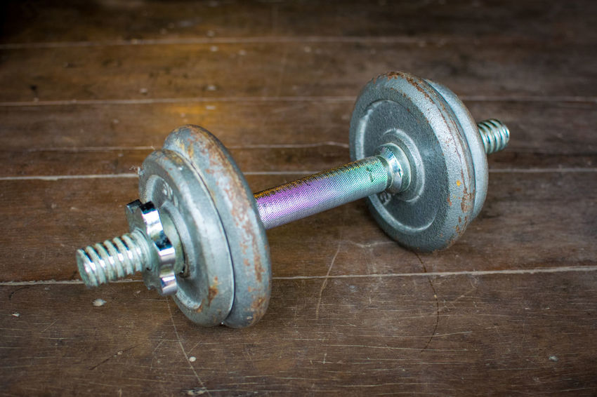 Metal dumbell on wood floor background Body & Fitness BodyBuilder Bodybuilding Exercise Iron Wood Aluminium Backdrop Background Close-up Color Colour Day Dumbbell Fit Fitness Floor Gym Health Healthy In Door Indoors  Kilo Metal No People Old Wood Sport Wood - Material