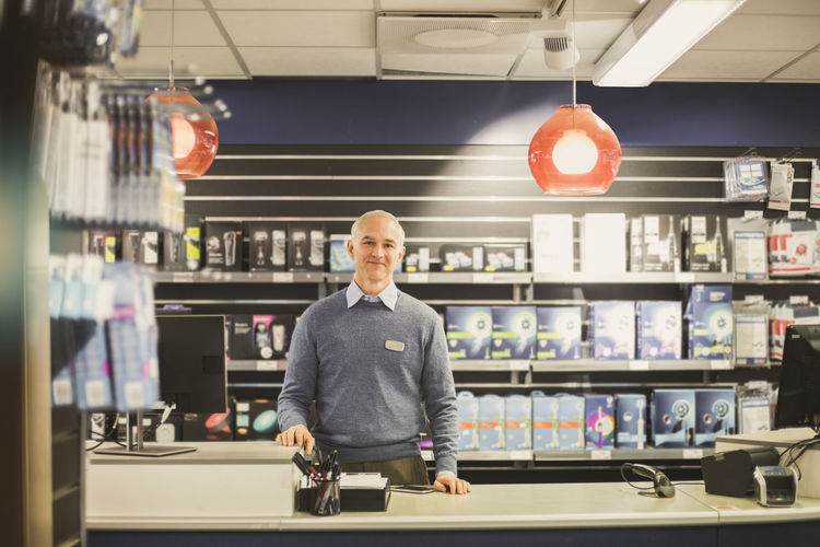 Portrait of man standing in store
