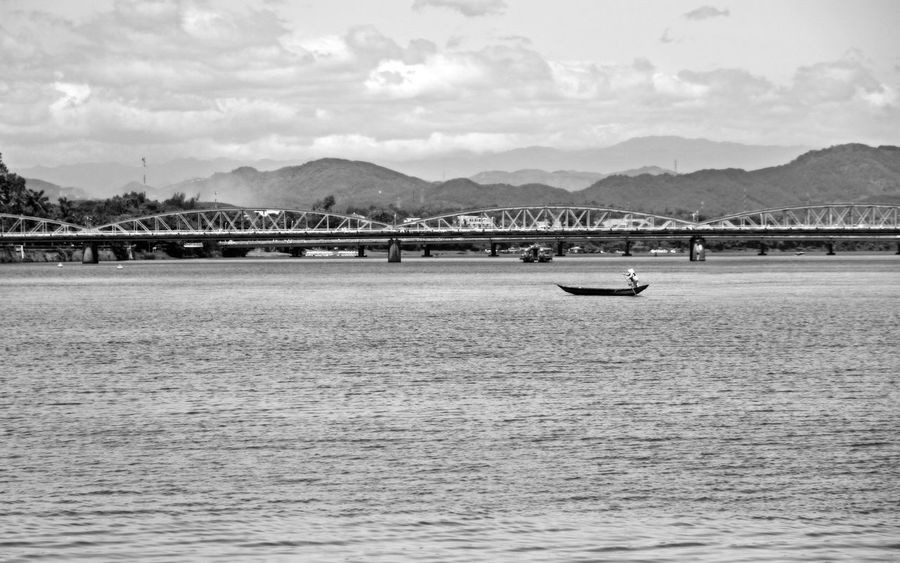 Hue city, Viet Nam Hanging Out Huong River Taking Photos Travel Architecture Bridge Bridge - Man Made Structure Built Structure Cloud - Sky Mountain Mountain Range Nautical Vessel Outdoors Passenger Craft Scenics - Nature Sky Transportation Water Waterfront The Traveler - 2018 EyeEm Awards