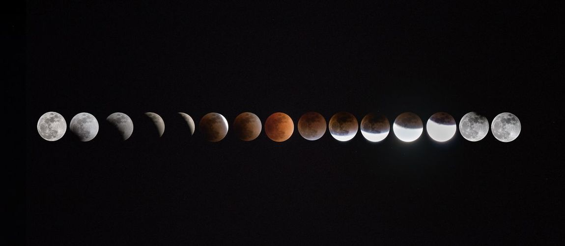 Multiple image of lunar eclipse against sky at night