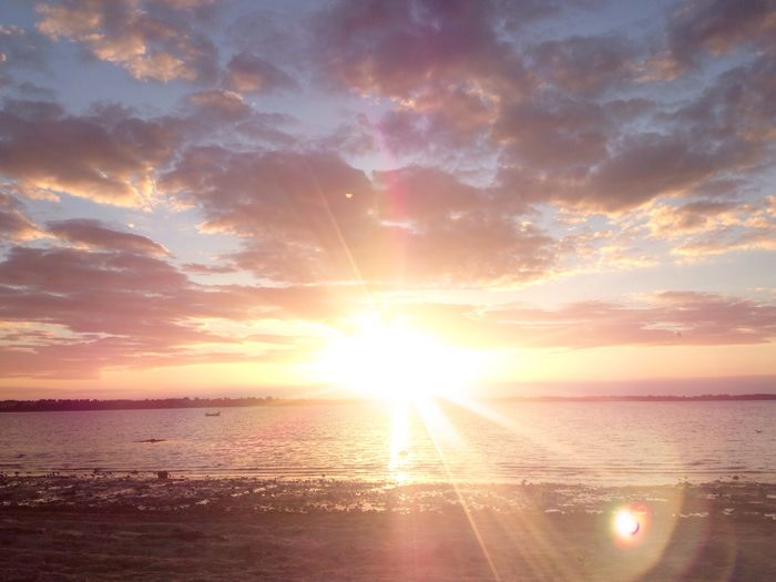 Sun Sunset Lens Flare Sea Sunbeam Water Sky Sunlight Scenics Nature Tranquility Beach Horizon Over Water Tranquil Scene Outdoors Idyllic Reflection No People Cloud - Sky Landscape Seascape
