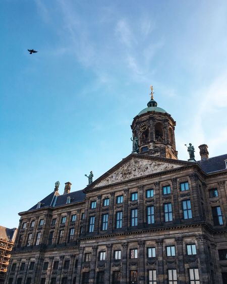 Royal palace of amsterdam against sky