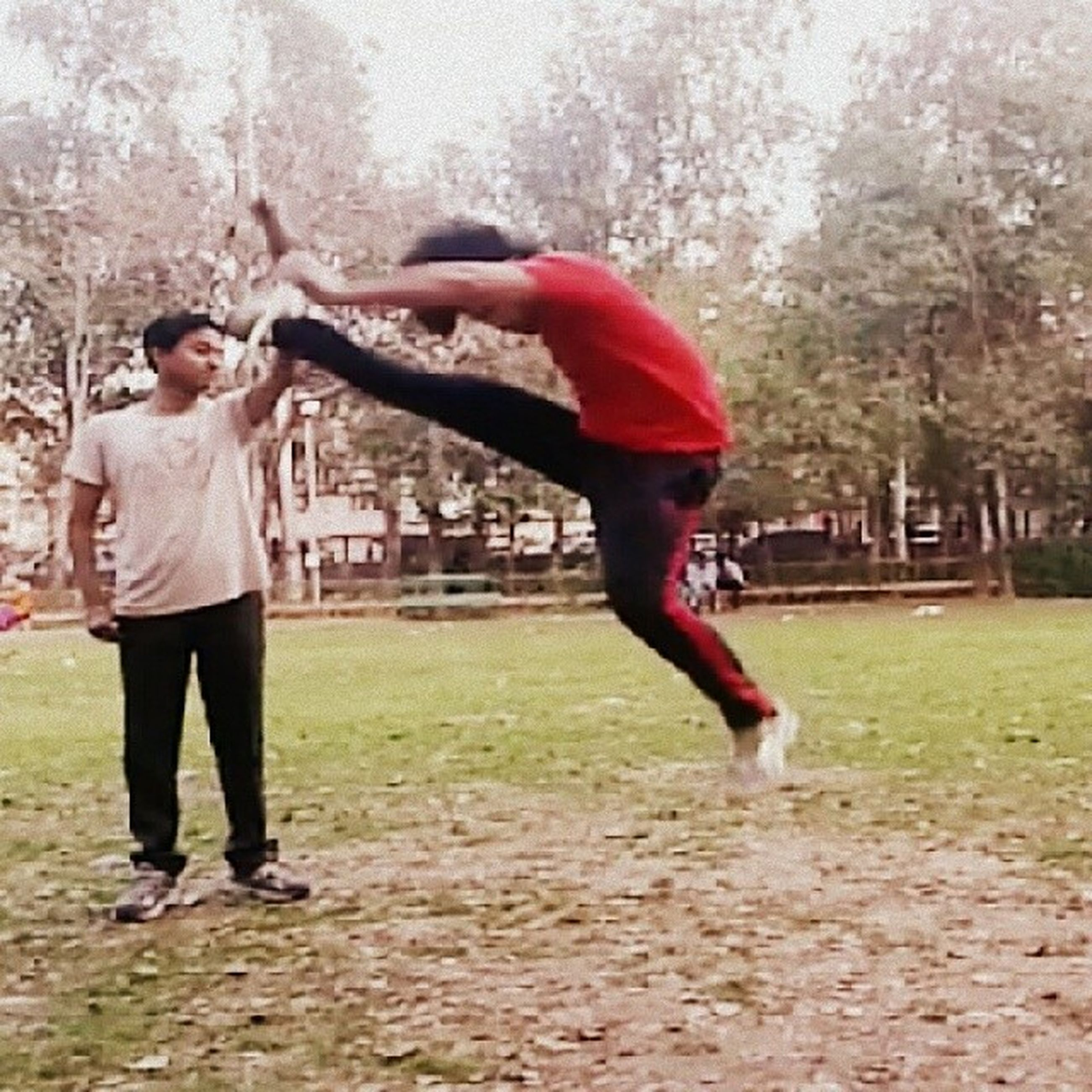 full length, lifestyles, tree, casual clothing, childhood, person, leisure activity, elementary age, jumping, playing, people, park - man made space, fun, playful, young adult, motion, front view