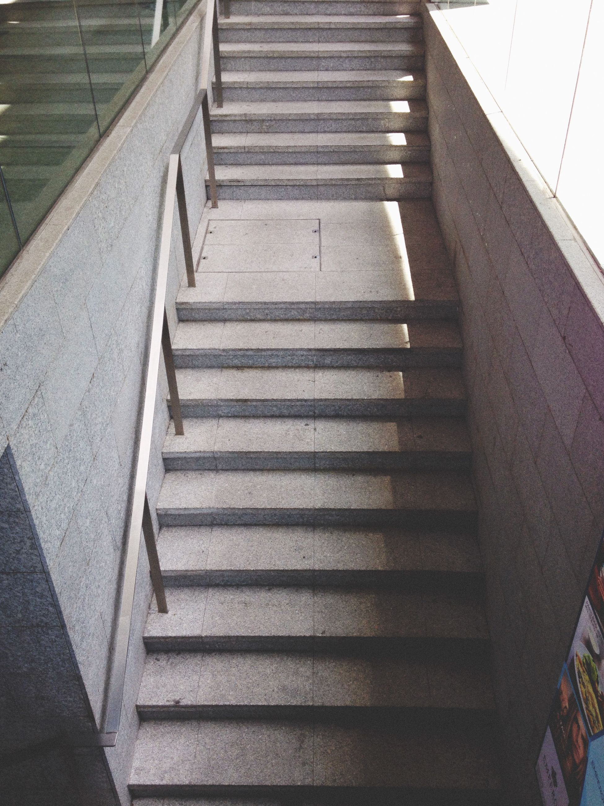 steps, staircase, steps and staircases, railing, high angle view, indoors, architecture, built structure, stairs, the way forward, low angle view, building, building exterior, escalator, diminishing perspective, sunlight, wall - building feature, day, no people, steps and staircase