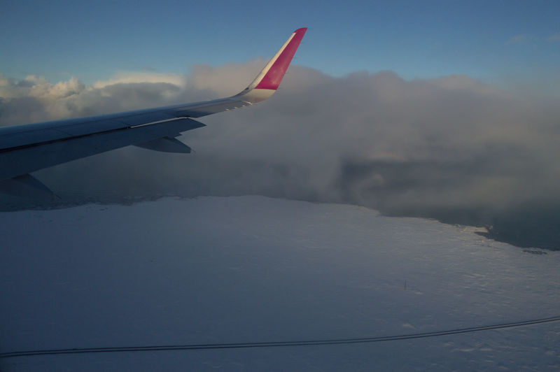 Iceland Europe Ice Snow In Flight Air Vehicle Airplane Aircraft Wing Flying Transportation Mode Of Transportation Cloud - Sky Travel Sky No People Beauty In Nature Nature Day Motion Scenics - Nature Mid-air Journey Mountain on the move Aerial View Outdoors Snowcapped Mountain