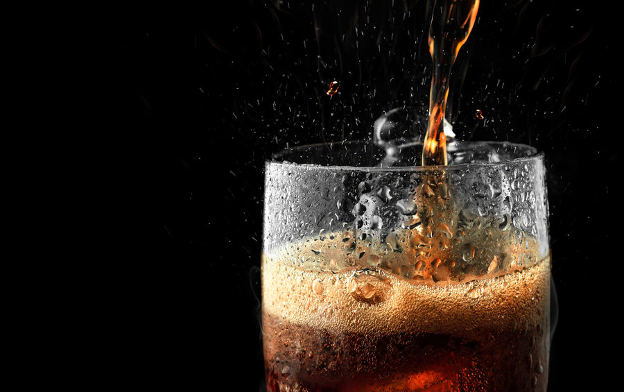 Soft drink glass with ice splash on dark background. Cola glass in celebration party concept. Drink Food And Drink Close-up Studio Shot No People Glass Refreshment Black Background Motion Drinking Glass Still Life Freshness Coke Cocacola Cola Soft Drink Softdrink Sweet Splashing Splash Refreshment Fresh Bottle Party Celebration