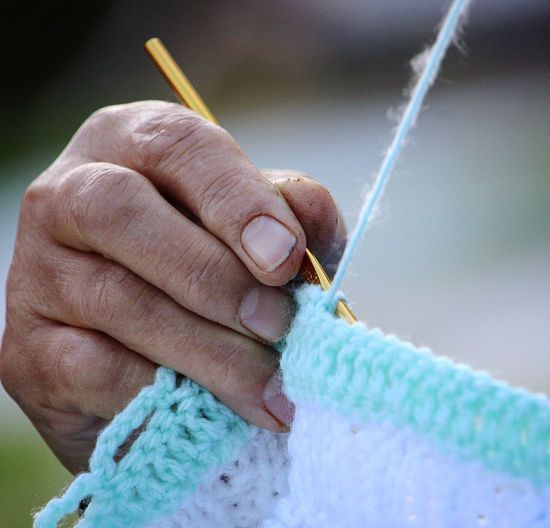Human Hand Human Body Part Knitting Wool Close-up Knitting Needle Skill  Leisure Activity One Person Outdoors Day Adult People EyeEmNewHere Eye4photography  EyeEm Gallery Buymyphotoplease The Photojournalist - 2018 EyeEm Awards