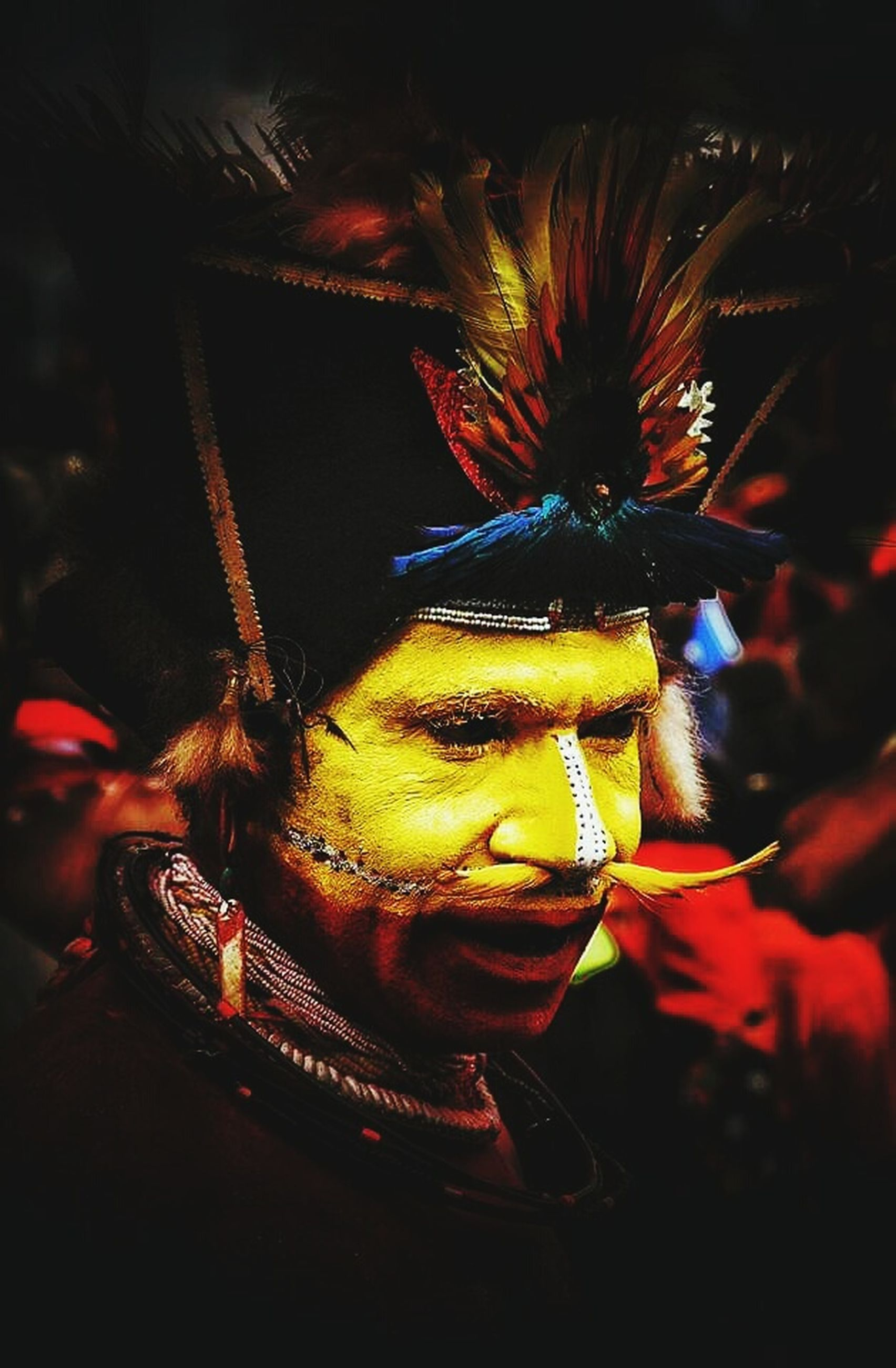art and craft, close-up, creativity, carnival, representation, indoors, feather, celebration, selective focus, decoration, multi colored, focus on foreground, one person, headwear, event, human representation, arts culture and entertainment, real people, carnival - celebration event, festival, ornate