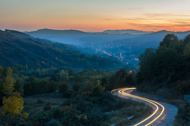Beauty In Nature Composition Long Exposure Mountain Nature No People Outdoors Road Sky Sun Sunset Tranquility Valley