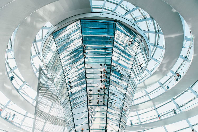Architecture Built Structure Glass - Material Modern Low Angle View Indoors  No People Ceiling City Building Shopping Mall White Color Business Day Elevated Walkway Geometric Shape Arch Architectural Feature Blue Clean Alloy Bright