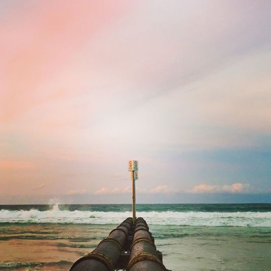 Manly beach stormwater pipes and the sunset reflected on the eastern sky! Halfcenturytraveller EyeEmBestPics Nature On Your Doorstep EyeEm Best Shots Travelphotography Travel Destinations EyeEm Gallery Sunrise_sunsets_aroundworld Sunset_collection Sunset Naturelovers Cloudscape Industrial Landscapes Industrial Photography Nature Photography