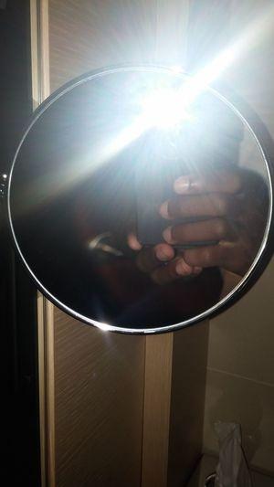 Reflection of people on illuminated mirror