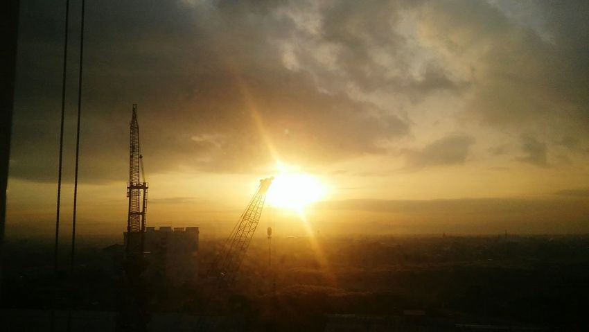 Sunrise Beauty In Nature Sunlight Dramatic Sky Scenics City Day Morning Morning Light Morningslikethese Morning View Start The Day Cranes And Construction First Eyeem Photo EyeEmNewHere No People Urban Skyline Paint The Town Yellow