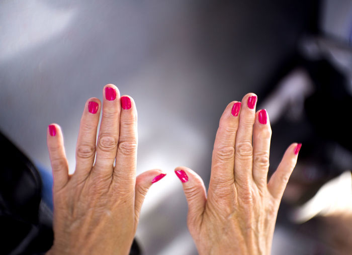 Adult Body Part Close-up Finger Focus On Foreground Hand Human Body Part Human Finger Human Hand Human Limb Indoors  Lifestyles Nail Nail Polish One Person Personal Perspective Real People Red Red Nail Polish Women
