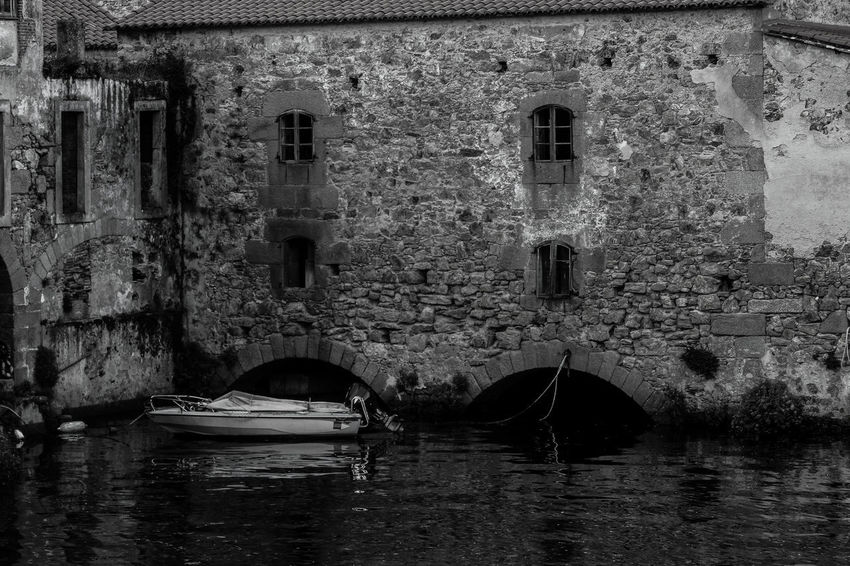 Riverside Arch Architecture Black And White Black And White Collection  Black And White Photography Blackandwhite Building At Waterside Building Exterior Built Structure Day Nature Nautical Vessel No People Old Building  Old Buildings Outdoors Riverside Photography Small Boat Stone Building Water Waterfront Black And White Friday