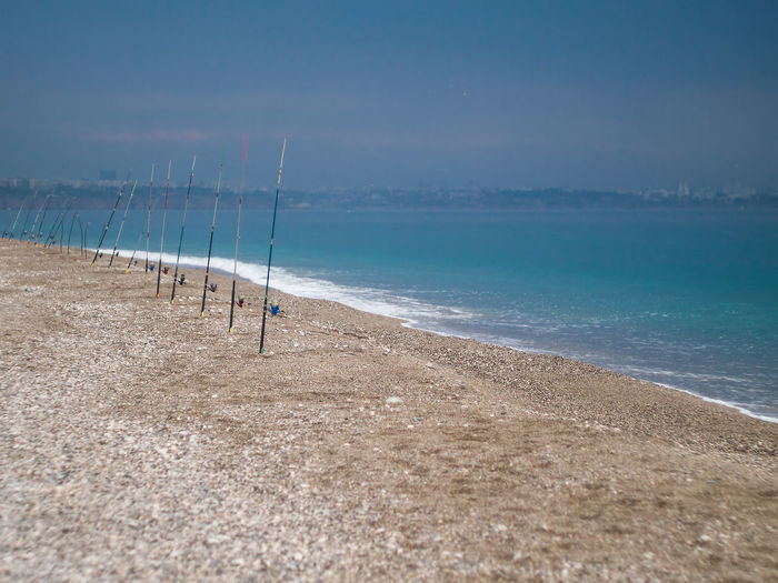 Fishing rods in row at beach