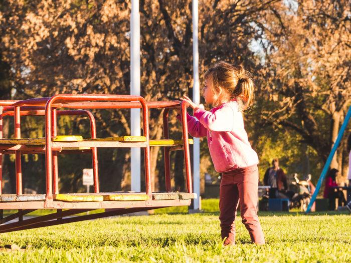 Full length of girl playing at play park