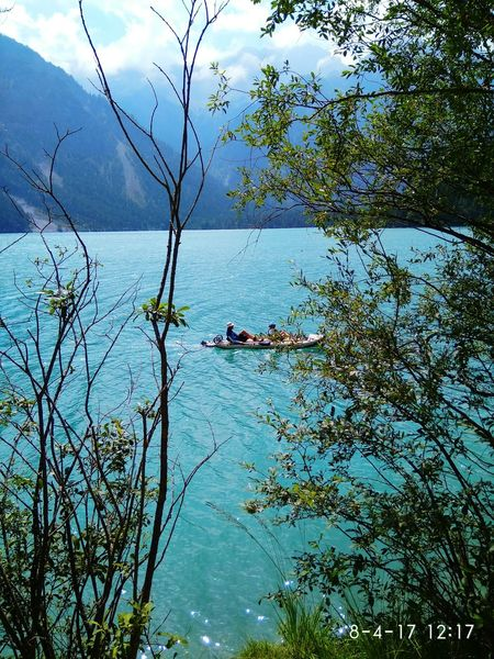 Outdoors Water Tree Lake Branch Beauty In Nature Nature Adventure Day Landscape Mountain Sport summerSky Beauty In Nature Green Color Travel Mountain Range r Mix Yourself A Good Time