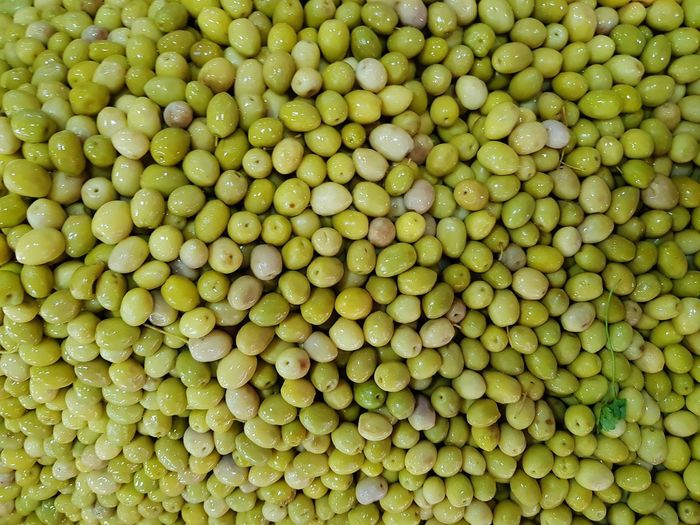 Aceitunas Verdes Olives Aceitunas Backgrounds Full Frame Close-up Green Color Food And Drink Sour Taste Dietary Fiber Market Stall Shore For Sale Rushing Fish Market Sandy Beach Zest Oat Flake Retail Display Street Market Various Price Tag Display Oats - Food Window Display Pebble Beach Blood Orange Flower Market Legume Family Stall