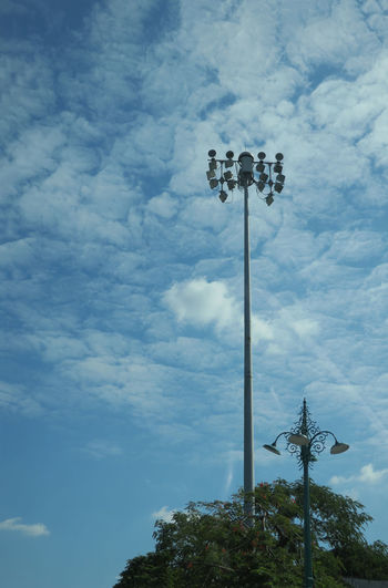 Old And Modern Cloud - Sky Day Floodlight Lighting Equipment Low Angle View Nature No People Outdoors Sky Street Light Style Tree
