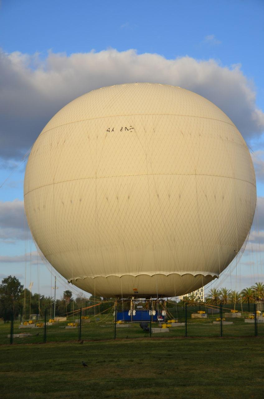 Hot Air Balloon At Park Against Cloudy Sky