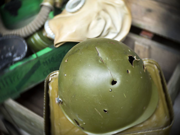 High angle view of pierced army helmet for exhibition at museum