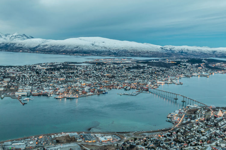 Aerial View Of Town By Sea During Winter