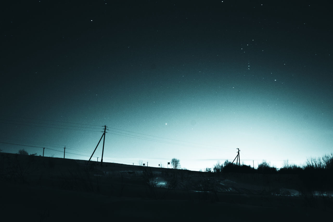 connection, no people, sky, nature, outdoors, night, silhouette, low angle view, cable, beauty in nature, electricity pylon, star - space, architecture, astronomy