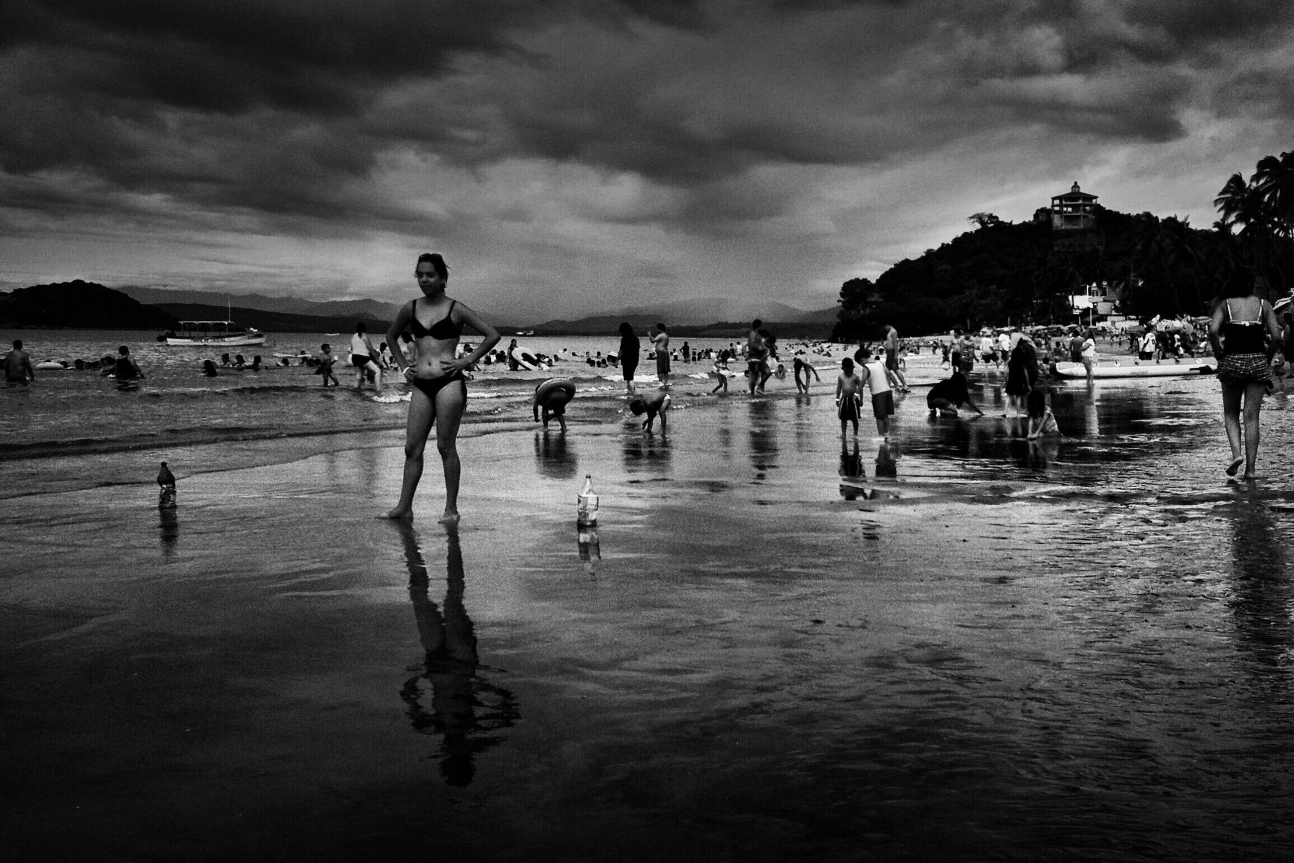 water, sky, sea, cloud - sky, shore, cloudy, cloud, nature, vacations, scenics, leisure activity, lifestyles, tranquility, beauty in nature, tranquil scene, outdoors, day, mixed age range, coastline, tourism, overcast, travel destinations, idyllic