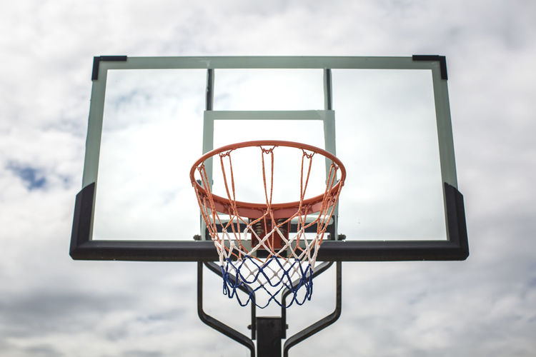 Basketball - Sport Basketball Hoop Net - Sports Equipment Sport Sky Cloud - Sky Low Angle View Day Team Sport Nature Leisure Activity No People Leisure Games Taking A Shot - Sport Competition Making A Basket Outdoors Sports Equipment Focus On Foreground Relaxation At The Edge Of Basketball Hoop