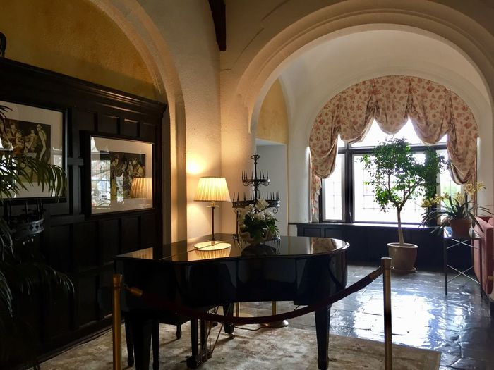 Architectural buildings hotel interiors musical instrument player piano arches window scalloped curtains Indoors  No People
