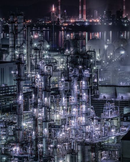 Illuminated oil refinery at night