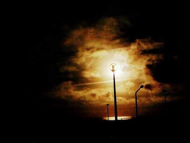 Silhouette Street Light Lighting Equipment Illuminated No People Sunset Outdoors Nature Sky Outdoor Outdoor Photography Sunlight The Architect - 2017 EyeEm Awards Figueira Da Foz, Portugal EyeEmNewHere The Street Photographer - 2017 EyeEm Awards The Great Outdoors - 2017 EyeEm Awards Daytime Beach Cloud - Sky Light Lights Light Up Your Life Outside Day