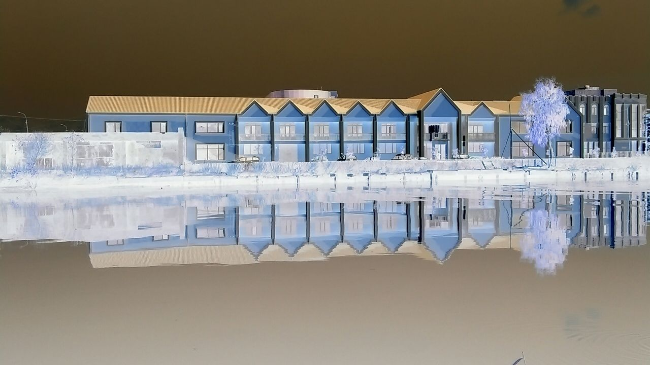 water, reflection, architecture, built structure, building exterior, outdoors, no people, day, sky, nature