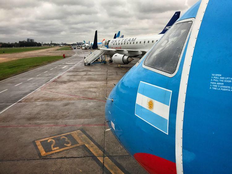 EyeEm Selects Airplane Airport Mode Of Transport Air Vehicle Airport Runway Transportation Passenger Boarding Bridge Airplane Wing