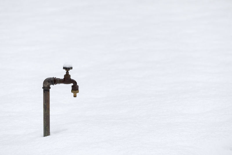Faucet On Snow Covered Field