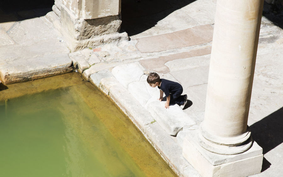 EyeEmNewHere United Kingdom Ancient Civilization Architectural Column Architecture Built Structure Casual Clothing Cityofbath Day Full Length High Angle View Leisure Activity Lifestyles Men Nature One Person Outdoors Real People Staircase Sunlight Water Young Adult