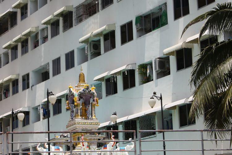 Religious Statue Against Building